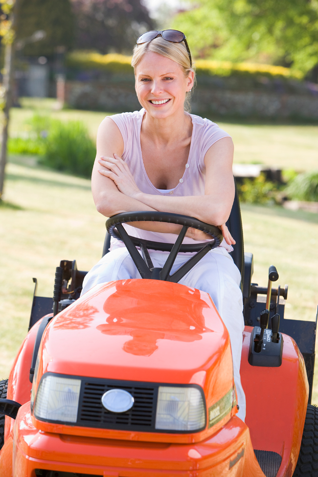 woman-outdoors-with-lawnmower-smiling_1000.jpg